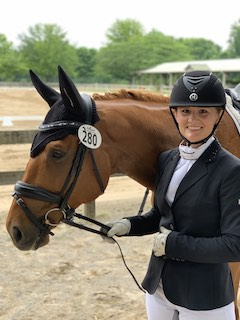 Picture of Dr. Anna Wallace with her equestrian horse